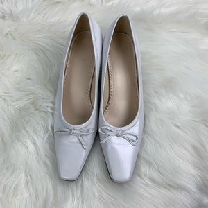 Naturalized white heels